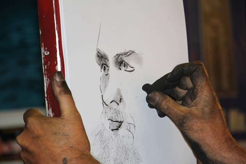 Charcoal portrait during an artist-themed river cruise