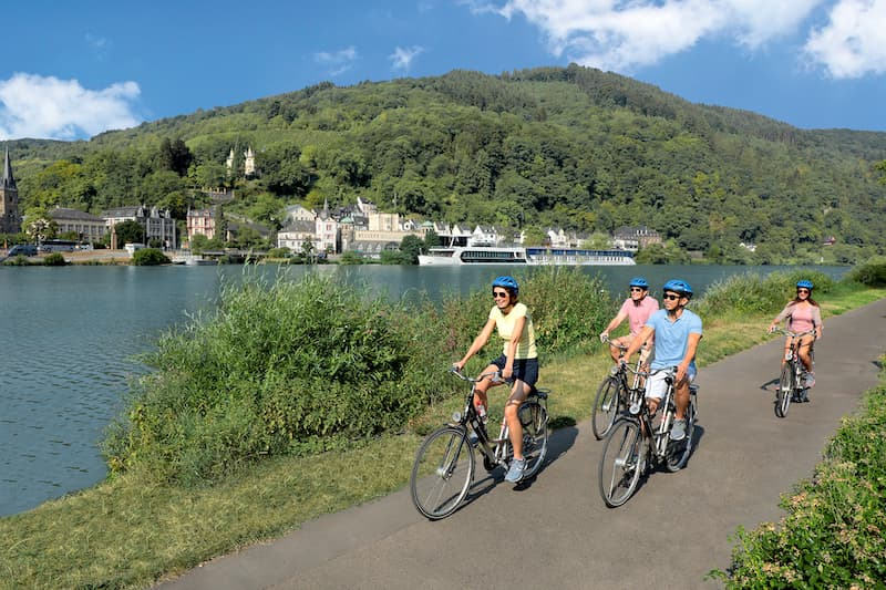 Four people biking along the Moselle River