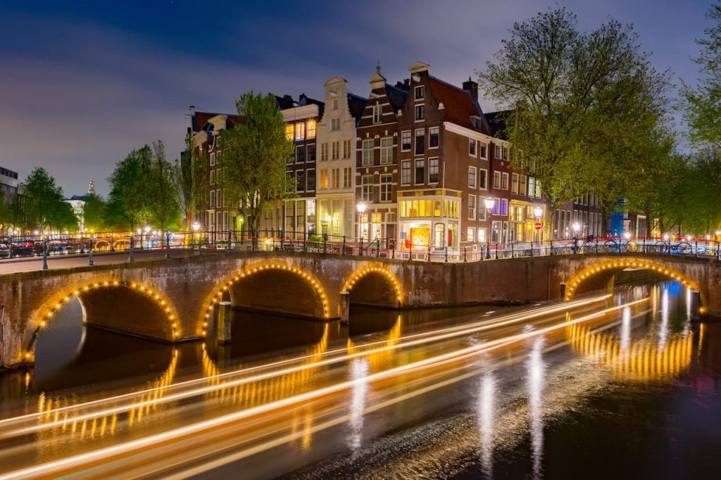 Amsterdam canal bridges with golden lights