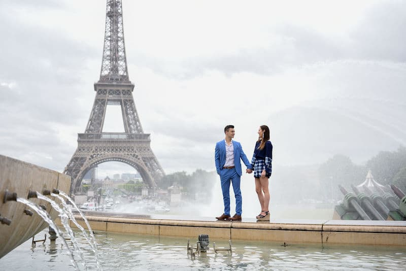 Romantic photoshoot of a couple standing in front of the Eiffel Tower in Paris