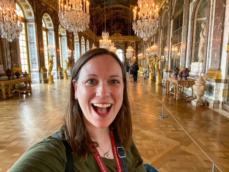 Cassie Tetro in an uncrowded Hall of Mirrors inside Versailles Palace