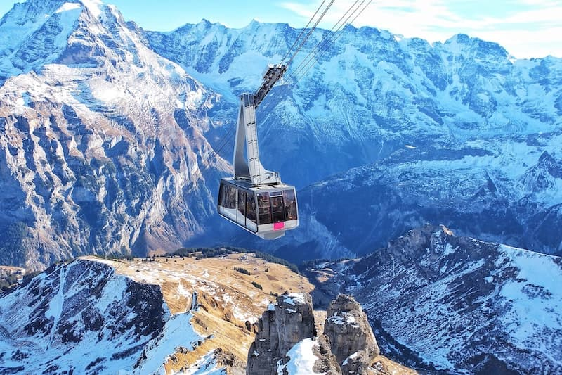 Ski gondola soaring over the Swiss Alps